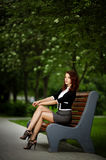 Beautiful girl sitting on bench Royalty Free Stock Photo