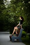 Beautiful girl sitting on bench Stock Photo