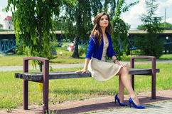 Beautiful girl sitting on bench Royalty Free Stock Photos