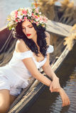 Beautiful girl sitting in the boat Stock Images