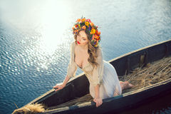 Beautiful girl sitting in the boat Stock Photos