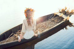 Beautiful girl sitting in the boat Royalty Free Stock Images