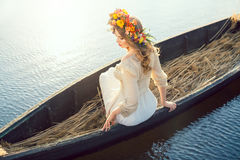 Beautiful girl sitting in the boat Royalty Free Stock Image