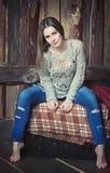 Beautiful girl sitting on the box. Beautiful girl sitting on the  rug covered box Stock Photo