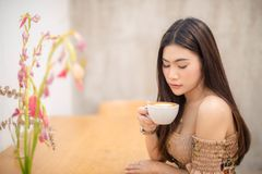 Beautiful girl sitting in a cafe stock photos