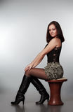 Beautiful girl sitting on chair Stock Images