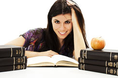 Beautiful girl sitting at the desk and reading book Royalty Free Stock Image