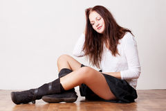 Beautiful girl sitting on the floor Stock Photo
