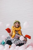 Beautiful girl sitting on the floor with knitted clothing stock image