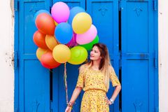A beautiful girl with ballons in hand royalty free stock photos