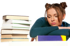 Girl sitting in front of books Royalty Free Stock Photography
