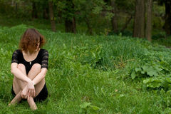 Beautiful girl sitting on grass Stock Photo