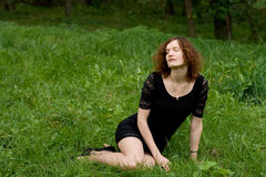 Beautiful girl sitting on grass Royalty Free Stock Photography