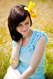 Beautiful girl sitting on the grass Royalty Free Stock Image