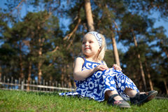 Beautiful girl sitting on green grass Royalty Free Stock Photography