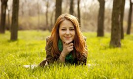Beautiful girl sitting at green grass at park. Stock Images