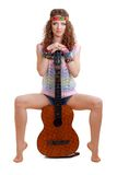 Beautiful Girl sitting on guitar Stock Image