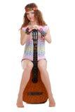 Beautiful Girl sitting on guitar Royalty Free Stock Image