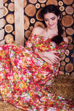 Beautiful girl is sitting on hay stack Royalty Free Stock Photo