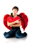 Beautiful girl sitting with heart Royalty Free Stock Photo