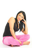 Beautiful girl sitting isolated on white Royalty Free Stock Photos