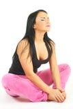 Beautiful girl sitting isolated on white Royalty Free Stock Photo