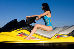 Beautiful girl sitting on jet ski Royalty Free Stock Image