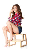 Beautiful girl is sitting on the ladder Stock Photos