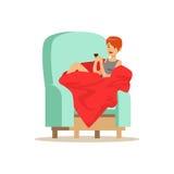 Beautiful girl sitting on a light blue armchair wrapped in a red blanket. Beautiful girl sitting on a light blue armchair wrapped in a red blanket, woman Royalty Free Stock Image