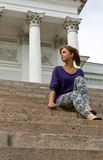 Beautiful girl sitting on the marble steps Stock Image