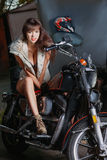 Beautiful girl is sitting on a motorcycle Stock Image