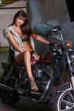 Beautiful girl is sitting on a motorcycle Royalty Free Stock Image