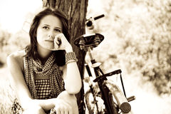 Beautiful girl sitting near bike.  Stock Photos