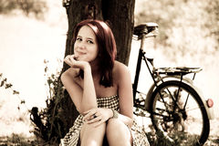 Beautiful girl sitting near bike. Stock Images