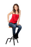 Beautiful girl sitting o a stool Stock Photos