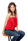 Beautiful girl sitting o a stool Stock Photography