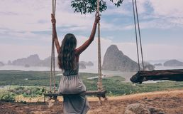 Free Beautiful Girl Sitting On Swing On The Top Of Hill With Fantast Royalty Free Stock Photography - 114501037