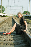 Beautiful girl sitting on the railway wi Royalty Free Stock Images