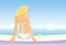 Beautiful girl sitting on a seaside. Stock Images