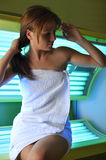 Beautiful girl sitting on a solarium. Beautiful Girl sitting on a green slarium Stock Images