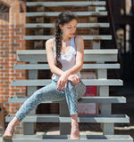 Beautiful girl sitting on stair. Royalty Free Stock Images