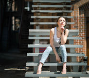 Beautiful girl sitting on stair. Stock Photo