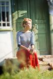 Beautiful girl sitting on steps of rural house Royalty Free Stock Photography
