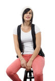 Beautiful girl sitting on a stool Stock Photos
