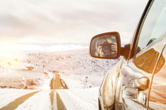 Beautiful girl sitting in an SUV riding in the mountains stock photo