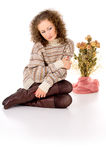 Beautiful girl sitting in a sweater Royalty Free Stock Photos