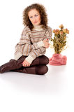 Beautiful girl sitting in a sweater isolated Royalty Free Stock Image