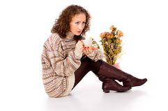 Beautiful girl sitting in a sweater Royalty Free Stock Photo