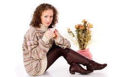 Beautiful girl sitting in a sweater with a mug Stock Photos