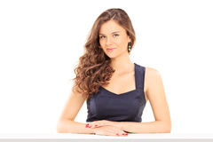 Beautiful girl sitting at a table Royalty Free Stock Photo